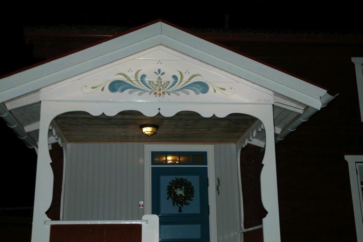 Main lodge front dorr with illuminated kurbits painting